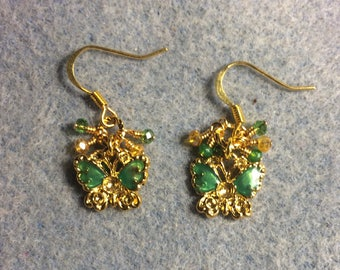 Small green and gold enamel butterfly charm earrings adorned with tiny dangling green and amber Chinese crystal beads.