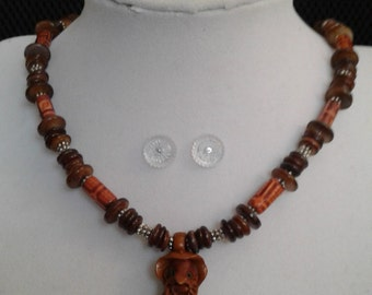 hand crafted, hand carved wooden gnome or troll, wood and silver beaded necklace.  19 inches long
