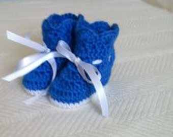 Baby blue booties with ribbons.