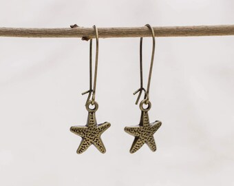 Earring with small star in bronze