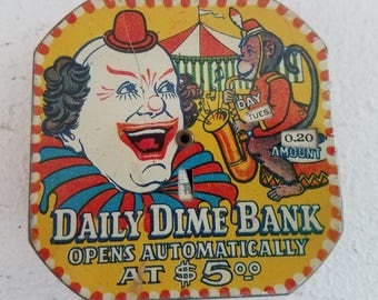 Vintage Clown Metal Daily Dime Bank