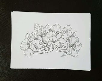 Bird skulls with flowers