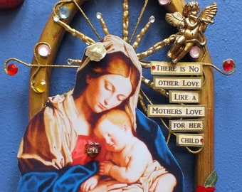 Religious mixed media wall hanging featuring Mary and baby Jesus.