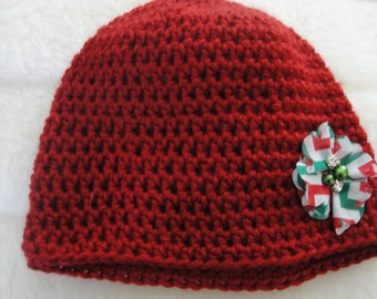 "Little red hat for a 12-18 month old with a Christmas flower. Handmade hat, crochet hat, winter hat, warm hat, Christmas hat, head circ.18""."
