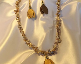 Pearlized rock chip necklace with naugahyde leaves with earrings
