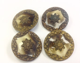 Set of four Victorian or Edwardian celluloid and metal buttons.