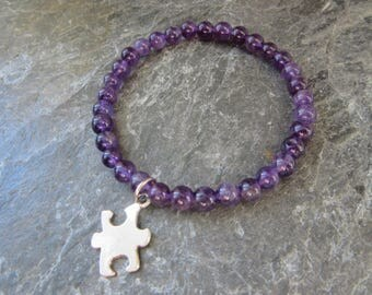Austism awareness - stretch bracelet in natural and genuine amethyst 6mm semi precious stone with puzzle charm Reiki infused