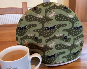 Tea cosy, Tea cozy with British burrowing badgers and rabbits,  green base with a contrasting spot lining, will fit a two to four cup teapot
