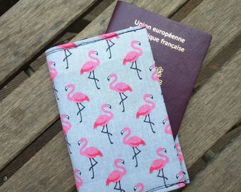 Passport flamingos on a grey background