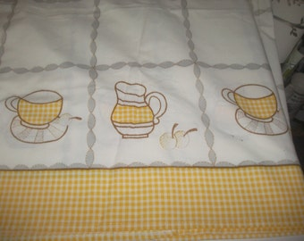 Yellow gingham bordered tablecloth. cup and saucer, teapot design. retro,