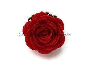Beautiful Felt Rose Ring Set Against an Antique Gold Filigree Backing