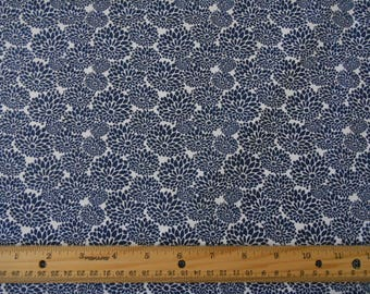 Navy blue flowers on white cotton fabric by the yard