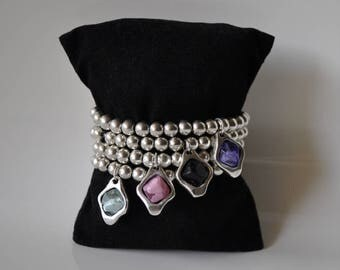 Zamak beads bracelet and resin stone pendant