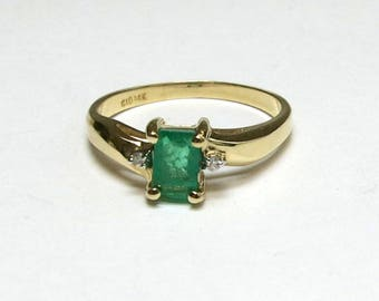 columbian emerald engagement ring emerald cut in 14k yellow gold