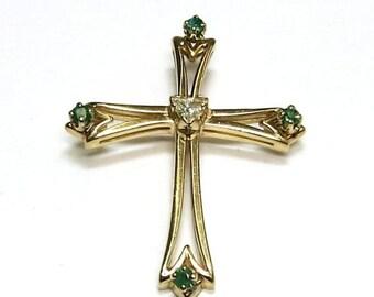 diamond and emerald cross pendant in 14k yellow gold