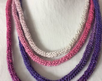Multistrand pinks and purples knitted necklace
