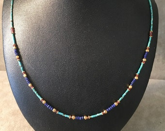 A fine strand of natural turquoise with lapis lazuli, cornelians & 18 carat gold