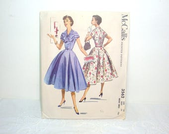 1950's dress pattern. McCall's #3562 from 1956, Spring or summer dress. Size 14, Bust 32 with instruction sheet and printed pattern pieces.