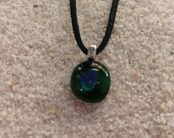 Small green clear glass pendant with a blue shimmer