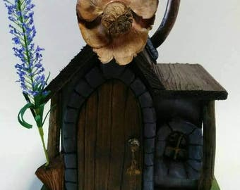 Wood and clay Fairy House