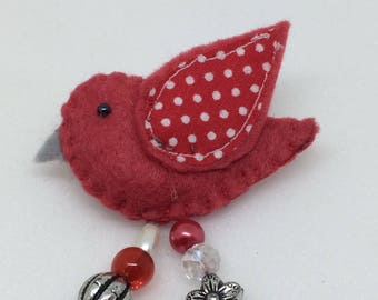 Felt bird brooch with spotty fabric wing and beads