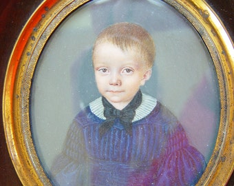 Antique miniature painting portrait of a little boy dated about 1830 framed with antique frame
