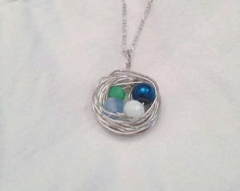 Necklace lengths can be requested. Each bird nest is hand made and will include your child's birth stone. Makes for a great mothers day gift