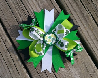 St. Patricks Day spiked hairbow with shamrock bottle cap center
