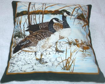 Canada Geese and Gosling by the waters edge cushion
