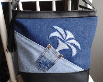 Handbag made of denim and faux with shoulder strap adjustable, lined, inside and outside pockets, really really soft