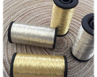 2 spools of Italian yarn type Skalli gold and silver