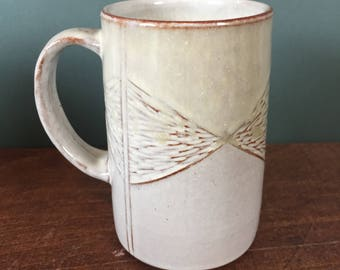 Handmade White Mug with Golden Ash and Carved Design