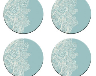 A pack of 4 paisley on teal background design design Pattern weights Ideal for weighing down patterns on delicate fabrics no need for pins