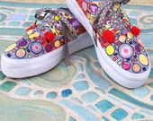 Hand painted platform sneakers whose bright and funky design gives them an other-wordly feel. Suitable for humans and aliens alike.