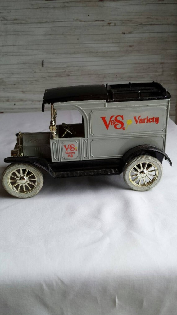 Vintage 1992 Ertl Die Cast Coin Bank. This Bank is a 1913 Ford Model T Van Advertising for V&S Variety. This Coin bank has the key.  No box.