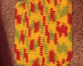 Green, red, and yellow crocheted dish cloth