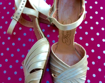 Beautiful 40's satin dance shoes, peep toes, approx size 3.5 or 4 UK. In good condition, very attractive and very wearable, leather soles.