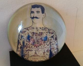 Tattooed man, glass paperweight, thick glass