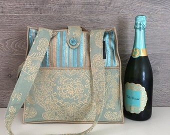 Buttoned turquoise and green tote bag made by hand from materials recycled and recovered in Quebec