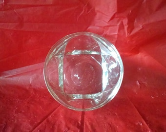Small clear, thick glass bowl, round at the top, square at the bottom, and a large thumbprint on each side; excellent condition