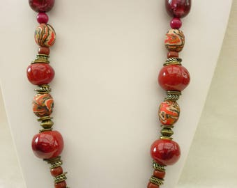 Necklace with  red brown orange  polymer beads