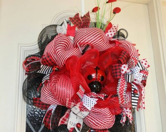 Lovley ladybug,  red,black, and white decomesh wreath.