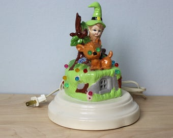 St. Patrick's Day - Leprechaun and Deer Sitting on a Cottage with Colored Plastic Beads Night Light