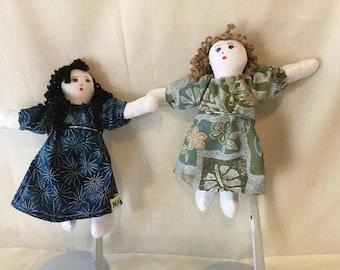 """Pocket dolls,dressed in Hawaiian fabric mumu. 7"""" tall."""