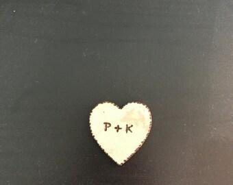 Little wooden engraved heart