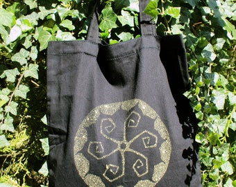 Black handbag with yellow flowers reasons psychedelic cotton fabric