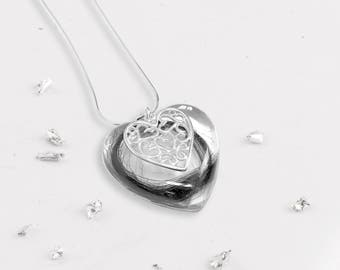 Large memorial heart pendant encapsulated with ashes or hair