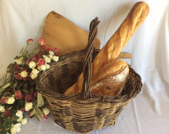Old vintage wicker basket bakery display traditional French bread display
