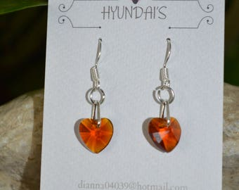 These earring's are a light brown glass heart,with a extra loop on a silver plated earring hook!