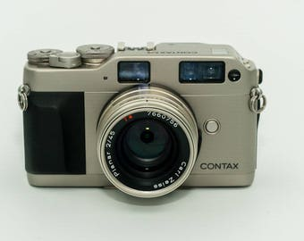 Contax G1 Rangefinder with various configurations with Zeiss Planar F2 45mm, Zeiss Biogon T* 28mm f2.8 or Zeiss Sonnar T* 90mm f2.8 lenses
